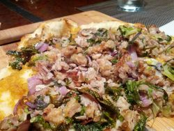 Crispy pork belly pizza, zesty peach marmalade, Wilted Kale