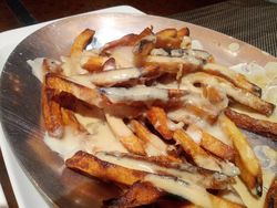 Poutine Duck Fat Fries with Foie Gras Gravey and Talegio Cheese