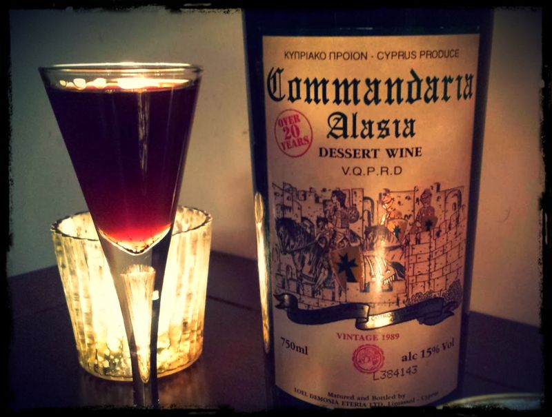 Commandaria Wine Bottle with Glass and Candles Framed