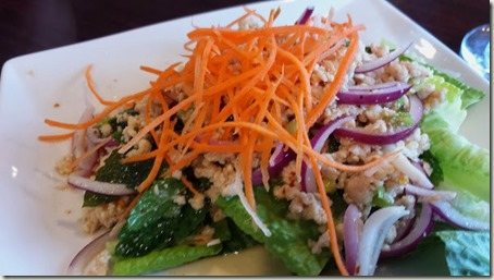 Larb Gai Marinated minced chicken or pork salad with onion, scallion, lime juice, and fresh Thai herbs